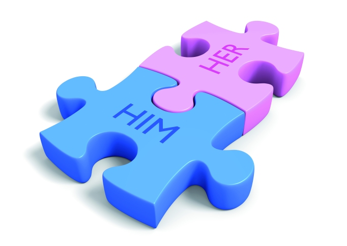 Matchmaking concept of puzzle pieces with the words him and her